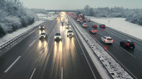 Dense traffic on German highway A3 in the winter - high-angle view Live Action