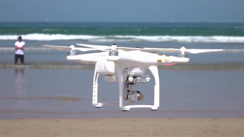 Video of drone flying by the ocean in real slow motion ビデオ