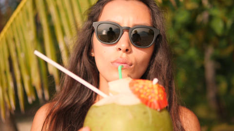 Portrait of Young Mixed Race Girl Drinking Fresh Thai Coconut Water Cocktail at Footage