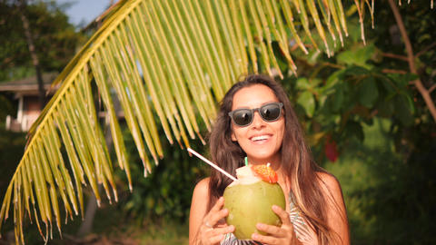 Young Happy Mixed Race Woman Drinking Fresh Thai Coconut Water Cocktail at Footage