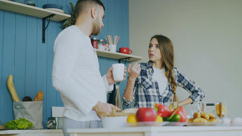 Young couple quarrels in the kitchen at home Footage