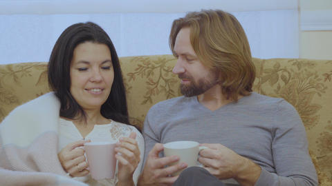 Portrait of happy married couple drinks tea Footage