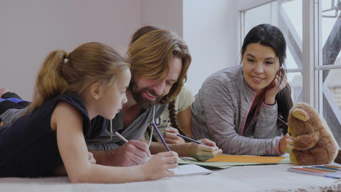 Happy family are drawing together at home Footage