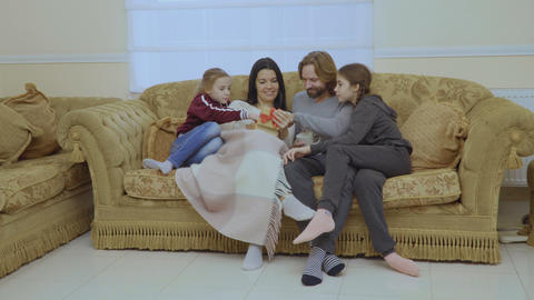 Happy family with christmas gift at the sofa at home Footage