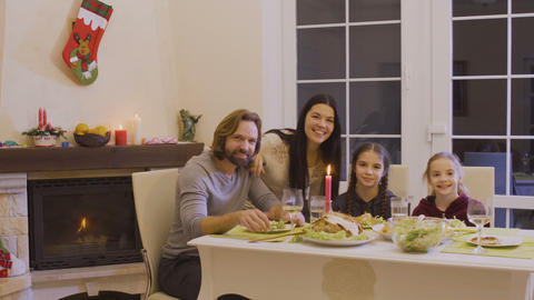 Happy family celebrates christmas at the festive table Footage