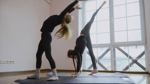 Two sisters demonstrates their flexibility and stretching Footage