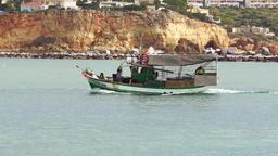 Green fishing boat passing by Footage