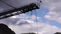 Mud drops off a conveyor belt 영상물