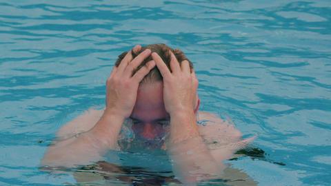 young man splash water in pool Footage