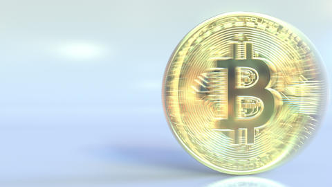 Realistic shiny bitcoin token spins across the frame and stops Footage