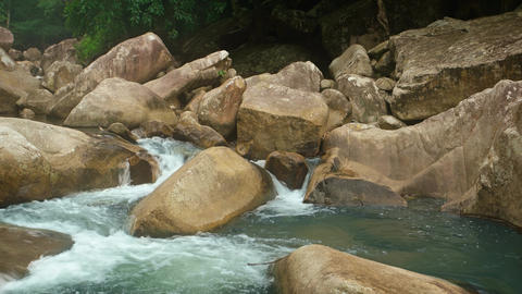 River in Vietnam Flows around Boulders. with Sound Live Action