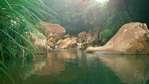 River Flowing over Rocks. Filling Natural Pool in Vietnam. with Sound GIF