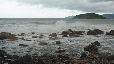 Waves Roll and Beak over a Rocky Vietnamese Beach GIF