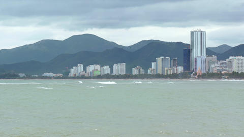 Nha Trang Cityscape over a Tropical Beach on a Cloudy Day GIF