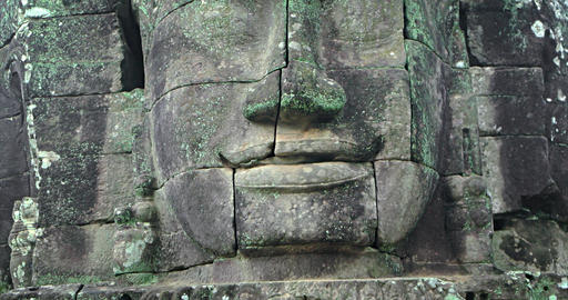 Closeup of Ancient Stone Face at Bayon Temple in Cambodia Live Action