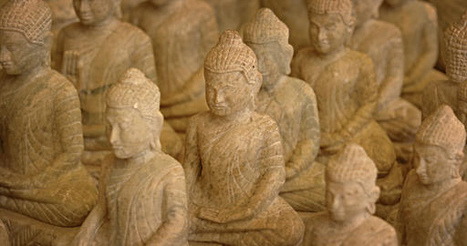 Small Buddha Sculptures at a Cambodian Craft Market GIF