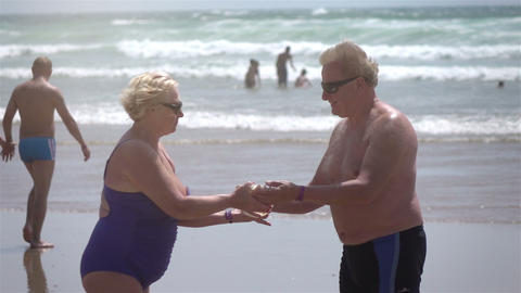 Video of senior couple on the beach in real slow motion Footage