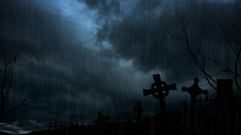 Spooky Headstones Silhouetted against a Stormy Night Sky GIF