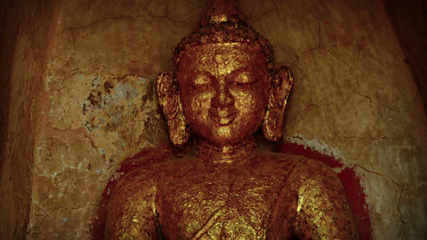 Ancient Buddha Statue Covered in Gold Leaf GIF