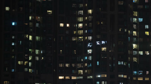 Illuminated Windows of a Highrise Residential Building at Night Image