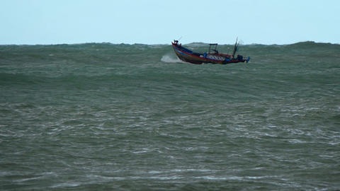 Small Fishing Boat on Rough Seas in Vietnam GIF