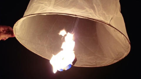 Friends Preparing to Release a Flying Lantern Together in Thailand Footage