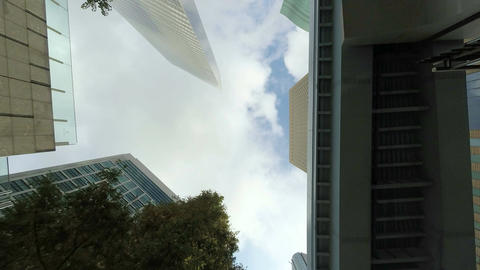 Low angle timelapse of cloudscape over the buildings and bridges in downtown Tok Footage