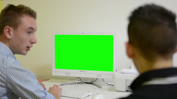 man works on computer - green screen - office - conversation between two men - p Footage