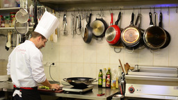 chef cooks food in the kitchen (restaurant) Footage