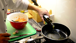 chef cooks food - chef pours oil in a frying pan Footage