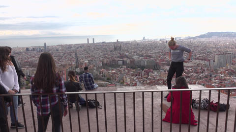 Young people enjoy panoramic city views, rest, take pictures, pose Footage
