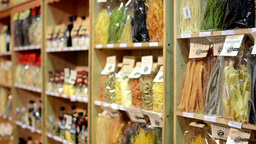 colourful pasta (olive oil, flour etc.) in bags in shelf - shop Footage