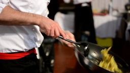 chef prepares food - chef cook pasta on frying pan - add cheese to pasta Footage