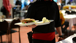 waiter carries meals to customers Footage