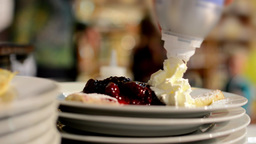 chef prepares a pancake (pour jam and whipped cream) Footage