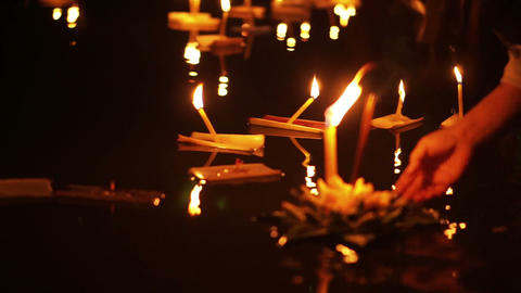 Loi Krathong Festival in Chiangmai, Thailand. Hand releasing floating decorated Footage