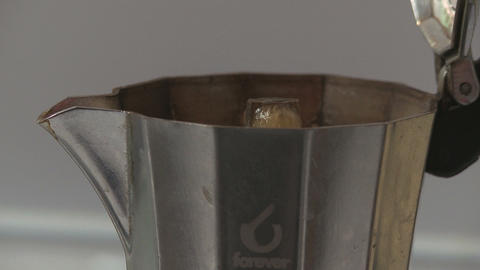 Italian coffee spills out from Moka close up Footage