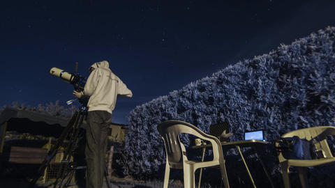 Color infrared timelapse of a guy doing some amateur astronomy in a garden with  Live Action