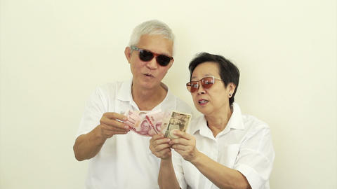 Video of happy rich Asian senior couple. Won lottery or casino cash Footage