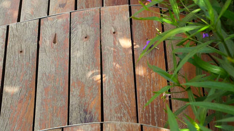 Video of Curved cut wooden deck in the garden Footage
