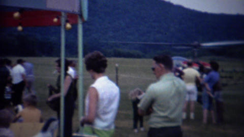 1962: Private Helicopter Landing Country Fair Amusement Park stock footage