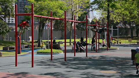 Playground swings at a city park in Kuala Lumpur. Malaysia Live Action
