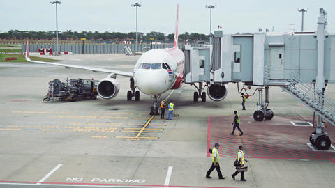 Ground Crew Preparing to Unload Passengers from Plane at Changi Airport Footage