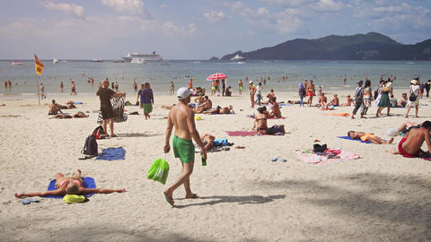 Happy Tourists on the Warm Tropical Beach with Cruise Ship in the Background Footage