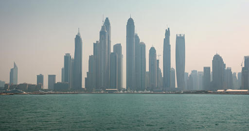 Timelapse Abstract of the Dubai Skyline over the Harbor Footage