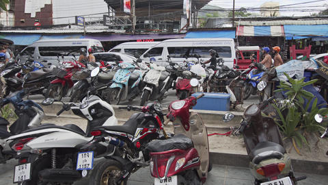 Crowded Motorcycle Parking along Patong's Busy Beach Road. with Sound Footage