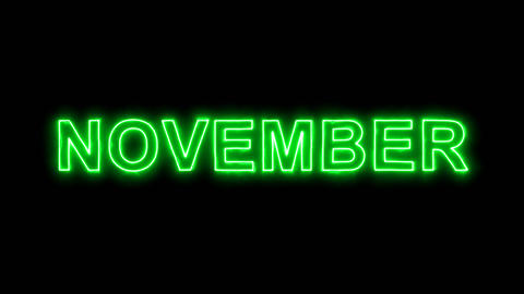 Neon flickering green name of the month NOVEMBER in the haze. Alpha channel Animation