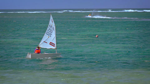 Happy Tourist Cruises in a Tiny. Rented Sailboat off Tropical Beach Paradise Footage