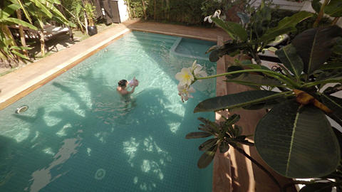 Mother and Baby Swimming in Pool on Sunny Day Footage