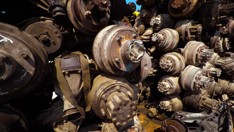 Old. Discarded Automotive Axles and Wheel Parts at the Junkyard Footage